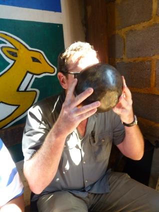 Wayne Dredge downs the Joburg Beer in The Shack, Johannesburg, South Africa