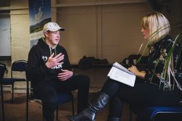 Dairy farmer Fraser Jones being interviewed by BBC Regional News Editor Joanna Tidman.