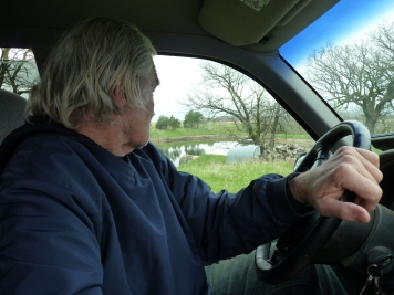 Garrison driving around his farm
